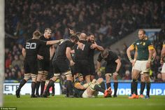 New Zealand players celebrate at the full-time whistle as they defeated South Africa 20-18 in Saturday's Rugby World Cup semi-final