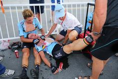 Guillaume Seye holds Enzo Wouters who fainted after the U23 race