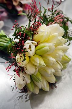 Fall inspired bridesmaid bouquet with white roses, red dahlias, burgundy zinnias... desc