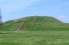 Monk's Mound Cahokia: Monk's Mound is in the ruins of the ancient Native American city of Cahokia in the U.S. state of Illinois. At its height, about 1,000 years ago, Cahokia was home to as many as 15,000 people. The mound was a series of rectangular terraces that reached 10 stories or 30 meters (100 feet) in height, and the area of its base was larger than the Empire State Building in New York City. The structure had a large public building at is apex, perhaps a temple.  Read more…