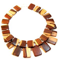 Korto Momolu wood necklace.