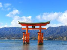 One of the most popular scenes in Japan. The Torii at Itsukushima Shrine on Miyajima Island, Hiroshima Prefecture, Japan.HDR image created from three sh. Torii at Itsukushima Shrine, Miyajima Japan Holidays, Miyajima, Hiroshima, Japan Travel, Marina Bay Sands, Gazebo, The Past, Tours, Outdoor Structures