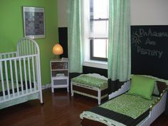 This parent has made the room comfortable for both children while creating a bit of separate space for the baby and toddler.