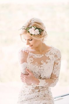Lace fitted illusion wedding dress with long sleeves + floral crown {Wedion Photography}