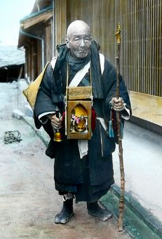 A faithful pilgrim with a God-in-a-box and khakkhara (sounding staff) by T.Enami