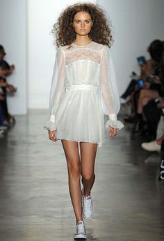 """Brides.com: . """"Rania"""" long illusion sleeve wedding dress with a soft pleated skirt, $1,450, Houghton"""