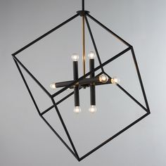 "Be Squared Modern Chandelier The asymmetrical design and use of mixed metals adds a modern element to this stately chandelier. The brass accents on the bronze finish create a handsome sophisticated look. 8x40 watt candle base T6 bulbs. (31.25""Hx25.5""W)"