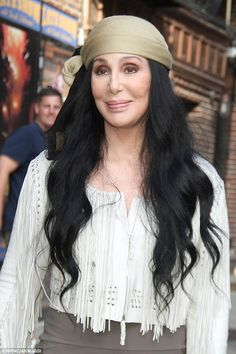 Topping it off:Really pushing home the pirate chic look, Cher even added a tan silk bandanna over her signature long black hair