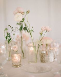 Blush blooms in apothecary bottles make a lovely wedding centerpiece  ~  we ❤ this! moncheribridals.com