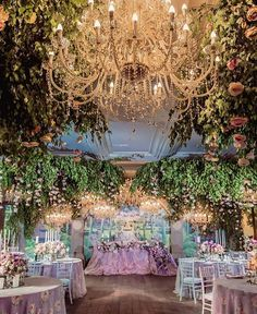 What about taking enchanted forest to an indoor wedding reception? Yes, please! We are swooning over this stunning decoration inspiration from @lidseventhouse and all elements inside it: The gleaming grand chandelier light, chic flowery tablescape, and the luscious greenery ceiling; all wrapped the place with an ethereal and magical atmosphere as if it was taken straightly from the fairy tale book! Who dreams of this kind of setup too? Double tap and share your thoughts with us below…