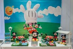 Fun backdrop and dessert table at a Mickey Mouse birthday party! See more party planning ideas at CatchMyParty.com!
