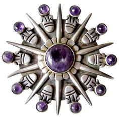 View this item and discover similar for sale at - Iconic Aztec sunburst amethyst and sterling silver brooch designed and created by William Spratling of Taxco, Mexico. Brooch measures a large in diameter Purple Jewelry, Amethyst Jewelry, Amethyst Stone, Sterling Silver Jewelry, Antique Jewelry, Vintage Jewelry, Silver Jewellery, Metal Jewelry, Jewelry Box