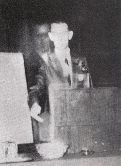 This photo was taken on November 16, 1968 when Robert A. Ferguson, author of Psychic Telemetry: New Key to Health, Wealth, and Perfect Living, was giving a speech at a Spiritualist convention in Los Angeles, California. Faintly appearing next to Ferguson is a figure he later identified as his brother Walter, who died in 1944 during WW II. This might seem to be a double exposure  but this  is a Polaroid (one of several taken of Ferguson at the time), making any kind of hoaxing quite unlikely.