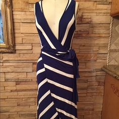 Moda International Blue Stripe Wrap Dress This super cute dress ties up in the front. Perfect for this summer or a great day on the beach! Super soft and comfortable fabric. Iconic sailor stripe color scheme. Moda International Dresses Asymmetrical