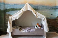 Bed tent, in camping room, woodland theme, mural, outdoors, campfire, camp out  The Ragged Wren - @Melody Woods - for Skylar and Jackson when you create their new room! Could be a reading chair too.