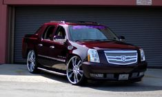 "Lexani Wheels, the leader in custom luxury wheels. 2010 Burgundy Cadillac Escalade EXT with 28"" chrome and purple LSS-55"