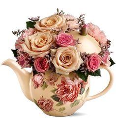 <3 flowers in a teapot. Flower arrangements