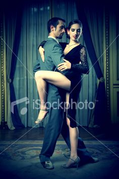 Young Couple Doing Tango Dance in Room, Low Key Royalty Free Stock Photo
