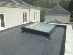 DVS installation of a large flat glazed rooflight.