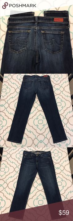 """💙👖Gorgeous AG Jeans👖💙27 3/4 23"""" Crop Dark Wash 💙👖Gorgeous AG Capri Jeans👖💙 Size 27R 27 Regular (3/4). 23.25"""" Inseam. Perfect for spring summer & fall. In the winter wear with tall boots. ; ) 7.5"""" Rise. Low Waist. 13.5"""" Across Back. Amazing Stretch. Beautiful Dark Blue Wash. Light Fading. The Dtevie Crop. Cropped. Cuffed. Capris. Excellent Used Condition. AG Adriano Goldschmied! Anthropologie! Ask me any questions! : ) AG Adriano Goldschmied Jeans Ankle & Cropped"""