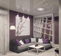 graues Ecksofa, lila Wandfarbe und weißer Raumteiler