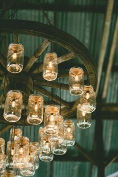 Mason Jar Chandelier, Mason Jar Lighting, Rustic Chandelier, Jar Lamp, Wagon Wheel Chandelier Diy, Chandelier Lighting, Mason Jars, Mason Jar Crafts, Diy Wedding