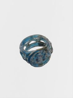 Glass openwork finger ring Period: Late Imperial Date: ca. 4th century CE Culture: Roman Medium: Glass Dimensions: H.: 9/16 in. (1.4 cm) Diam.: 13/16 in. (2.1 cm) Classification: Glass Credit Line: Gift of J. Pierpont Morgan, 1917 Accession Number: 17.194.344
