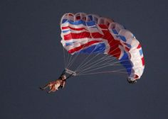A performer playing the role of Britain's Queen Elizabeth parachutes from a helicopter during the opening ceremony on July 27, 2012. (Reuters/Fabrizio Bensch)