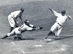 Babe Ruth slides safely into home during a 1934 Yankees-Tigers game.