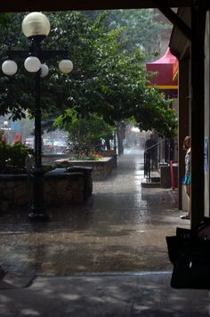 Seeking shelter on Baker Street Nelson, BC. I love and miss the rain! O Canada, Canada Travel, Western Canada, Laundry Hacks, When It Rains, Best Places To Travel, Baker Street, Lake Life, Rainy Days