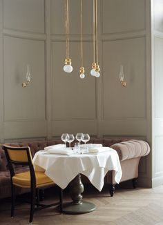 Simple and Elegant, bring the ceiling to the table in an unobtrusive way