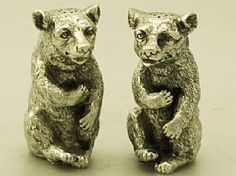 A fine and impressive pair of vintage Elizabeth II English cast sterling silver pepper pots modelled in the form of bears; part of our silverware collection  http://www.acsilver.co.uk/shop/pc/Pair-of-Sterling-Silver-Bear-Pepper-Pots-Vintage-Elizabeth-II-161p3732.htm