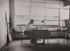 A young Bauhaus designer, Siegfried Giesenschlag, at work in the dorm.