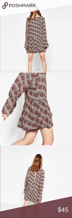 Zara printed jumpsuit Brand new with tags. Comes a little larger in size. Very comfortable Zara Dresses Midi