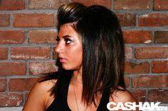 Medium length dark hair with caramel highlights.... with pompadour.