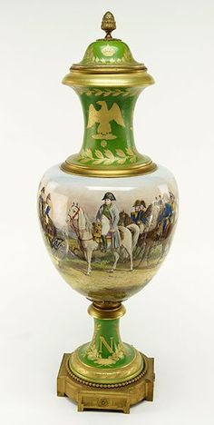 "A French Sevres Porcelain Covered Urn. Decorated with Napoleonic scenes, and emblazoned with a stylized ""N"" and eagle. Side of urn is signed ""H. Desprez Sevres"". Underside of urn cover is stamped ""M/Imp le de Sevres Lena 1806"" 35"" x 12"""