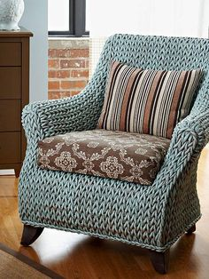 Revive a Wicker Chair by painting it. Who knew that was even possible! Wicker doesn't look so horrible when it's a nice color.