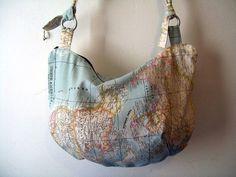 A slouchy messenger world map bag