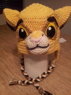 "This crocheted hat. 20 Awesome ""Lion King"" Items You Can Buy On Etsy Crochet Lion, Newborn Crochet, Crochet Baby Booties, Hat Crochet, Disney Crochet Hats, Crochet Kids Hats, King Hat, Crochet Character Hats, Crochet Square Blanket"