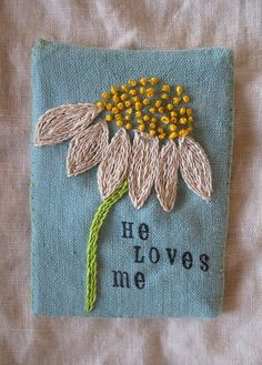 Hand embroidered Daisy on linen by peregrine blue, via Flickr