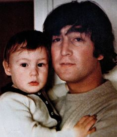 ♡♥John Lennon holds his first born son Julian - click on pic to see a full screen pic in a better looking black background♥♡