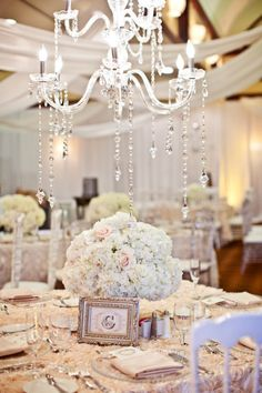 Wedding Tablescape Ideas & Decorations. White wedding, crystal chandelier, white and silver, white roses, formal reception, formal event.
