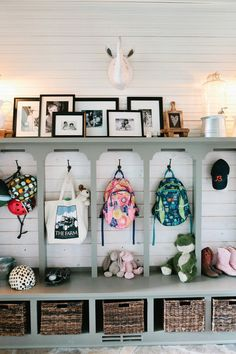 Shiplap planked wall behind locker-style entryway cubbies. So perfect! | 100+ Beautiful Mudrooms and Entryways at Remodelaholic.com