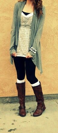 Leggings, boots, cardigan, and blouse.