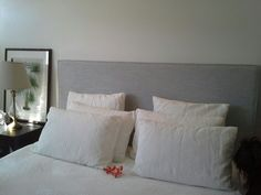 Just like todays weather, a picture perfect photo sent in by one of our happy customers of their custom made bed (bedhead and base).  Charming and Elegant, this bedhead was created using a light grey Warwick fabric. To provide a sharp edge on the top and side, thin piping was added.  Create your very own Quality bed today at a price you can afford. Get in touch, visit our showroom, shop online or make contact to get free samples sent your way.  www.bedsahead.com.au