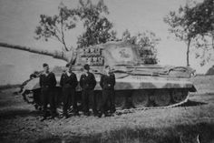 Crewmembers of King Tiger '321' pose in front of their new tank at the Ohrdruf Training Area in August 1944. The insignia of the schwere Panzer-Abteilung 505 (the charging knight) is painted right in the middle of the turret side on a rectangle that is cleared of the Zimmerit paste.