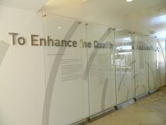 Institute on Aging: Glass donor panel floating above fabricated stainless steel lettering. Donor Wall, Glass Room Divider, News Space, Glass Panels, Signage, Walls, Stainless Steel, Lettering, Furniture