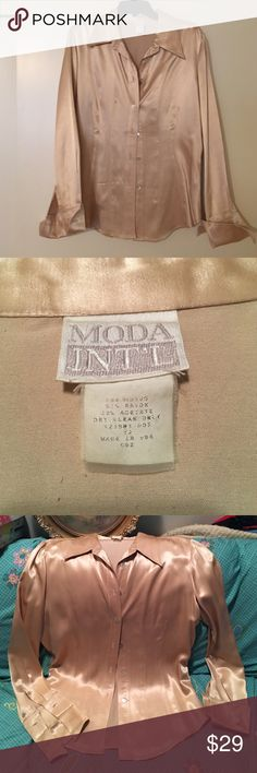 "Moda Int'l Ivory satin VINTAGE ladies blouse Beautiful cream colored satin blouse. Ladies medium. Has French cuffs which require cufflinks. Cufflinks not included. This top has been custom fitted and I am a size 36d 28"" waist, a size 6 usually. Moda International Tops Button Down Shirts"