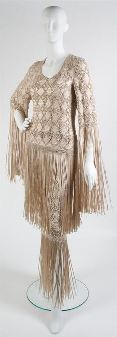 A Fontana Beige Silk Ribbon Evening Ensemble, 1970s, comprised of a poncho style top and skirt, exaggerated fringe. No Label