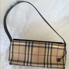 Authentic Burberry Purse Authentic Burberry shoulder bag. Body of the bag and handle are in excellent condition, interior is clean with no stains. Exterior corners have minor scuffs. See pictures. No trades. TB1010. Burberry Bags Shoulder Bags